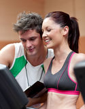 Heerful athletic woman standing on a treadmill Royalty Free Stock Photography