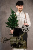 ?heerful projectionist with ?hristmas tree in their hands Royalty Free Stock Photo