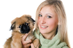 Сheerful woman with a pekinese Royalty Free Stock Photography