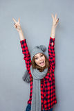 ?heerful woman showing peace sign stock image