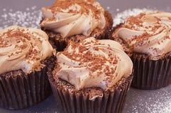 Heerlijke chocolade vier cupcakes Royalty-vrije Stock Afbeelding