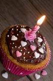 Heerlijke cupcake met kaars en copyspace Royalty-vrije Stock Afbeeldingen