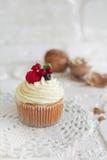 Heerlijke cupcakes met bessen stock afbeelding