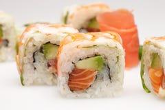 Heerlijke die sushi op witte achtergrond worden geïsoleerd Royalty-vrije Stock Afbeelding