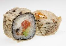 Heerlijke die sushi op witte achtergrond worden geïsoleerd Royalty-vrije Stock Fotografie