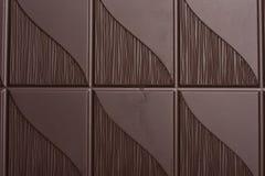 Heerlijke donkere chocoladeachtergrond Stock Afbeeldingen