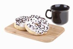 Heerlijke donuts met koffie Stock Afbeelding