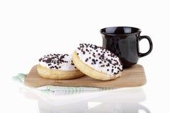 Heerlijke donuts met koffie Royalty-vrije Stock Foto's