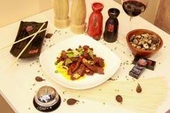 Heerlijke maaltijd door Chinese chef-kok Stock Foto