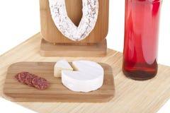 Heerlijke salami, kaas, wijnclose-up Stock Foto