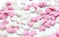 Heerlijke suikerlollys op abstract suikergoedpatroon als achtergrond Royalty-vrije Stock Afbeelding
