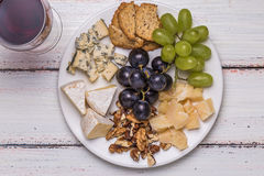 Сheese plate with wine Royalty Free Stock Photography