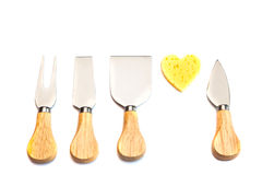 Сheese on shape as heart and knives isolated on white Stock Images