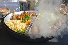 Heet voedsel in de landbouwmarkt van de de wintertijd Stock Foto's