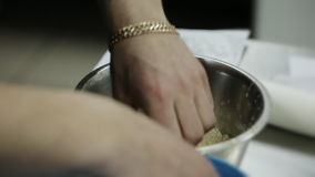 Hef prepares in the kitchen chicken legs, fast food stock video footage