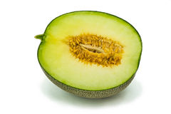 Heft der Melone auf dem weißen Hintergrund lizenzfreies stockfoto
