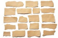 Heftige oder zerrissene Blätter Papier des wirklichen braunen Papiers der Sammlung im weißen Hintergrund Lizenzfreies Stockbild