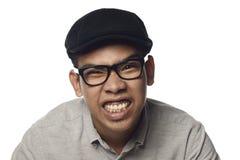 Heftiger grinsender malaysischer Mann Lizenzfreies Stockfoto