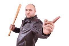 Heftiger Mann mit Baseballschläger Stockfoto