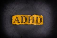 Heftiges Blatt Papier mit Abkürzung ADHD Stockfotos