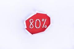 Heftiges Papier mit einem 70% Wort auf rotem Hintergrund Lizenzfreie Stockbilder