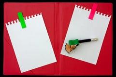 Heftiges Papier und Bleistift Stockbild