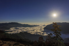 Hehuanshan and moon raise stock photography