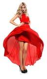 Heiße blonde Frau im roten Kleid Lizenzfreies Stockfoto