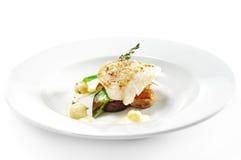 Heiße Fischgerichte - Heilbuttverkleidung stockfoto