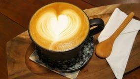 Heiße grüner Tee Lattekunst Stockfoto