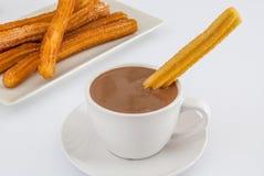 Heiße Schokolade mit churros lizenzfreies stockfoto