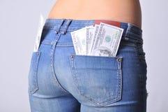 Heißer Mädchenesel mit Dollar in bar Lizenzfreie Stockfotografie