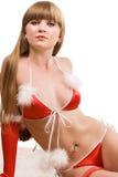 Heißes junges Mädchen in der roten Weihnachtswäsche Stockfotografie
