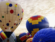 Heißluftballone bei Sonnenaufgang Lizenzfreies Stockfoto