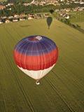 Heißluftballone und -schatten Lizenzfreie Stockfotografie