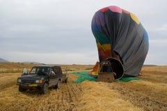 Heißluftballonlandung Stockfoto