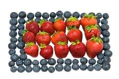 Heidelbeeren und Erdbeeren. Stockfotografie