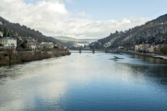 View from the Old Bridge Alte Brücke in Heidelberg, Germany. Heidelberg is a college town in Baden-Württemberg situated on the river Neckar in south-west Stock Photos