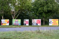 Heidelberg, Germany – September 17, 2017: Election campaign billboards of different parties for the Bundestag election on 24 Sep Royalty Free Stock Photos