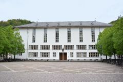 Full view of main building of Ruprecht-Karls-University with statue of Roman goddess of wisdom Minerva above entrance stock photography