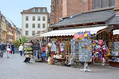 Souvenir shops offering various local trinkets with tourists in front of Church of the Holy Spirit called `Heiliggeistkirche` at m royalty free stock photography