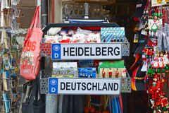 Tourist shop booth with different souvenirs related to the city of Heidelberg in Germany with license plate, plush toy bears, bags stock photography