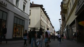 German and foreigner travelers people walking and visit heidelberger market stock video
