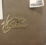 Love Moschino logo. Heidelberg, Germany - August 24, 2017: Love Moschino label. Moschino is an Italian luxury fashion house, specialized ready-to-wear, leather Royalty Free Stock Photos