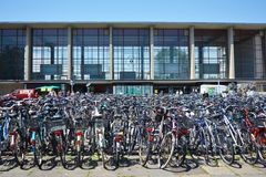 Many parked bicycles in front of Heidelberg main station royalty free stock image