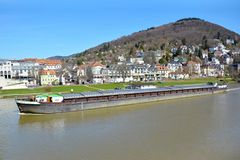 Long transport ship with cargo swimming across Neckar River stock photography