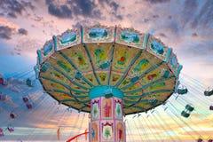 Empty chair swing ride at fun fair