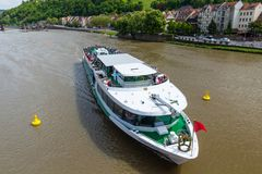 Heidelberg, Germany - May 6, 2017: River cruise ship on the Neck. Ar in Heidelberg. River cruises on scenic Neckar River are popular for visitors of Heidelberg Stock Images