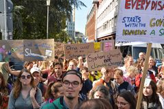 Demonstrants marching with protest signs held up during Global Climate Strike event