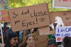 Protest sign saying `So don`t close your eyes` held up by young people during Global Climate Strike and Fridays for future protest